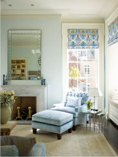 chair with two windows for reading. ikat roman shade. steven gambrel