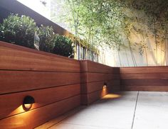 designer Wood Planter Boxes | Terrace with custom planter box built with mahogany wood contemporary