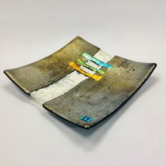 How gorgeous is this? I'm in love with this fused and slumped platter! It shimmers with gold metallic glass, dichroic glass, and silver foil. Each piece is unique and will vary slightly.