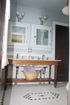 We love this DIY sink console--a reader's DIY project made from a salvaged marble counter top and double sinks along with an old table that was refinished and outfitted with a skirt and bottom shelf to match.   thisoldhouse.com
