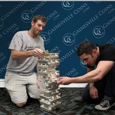 "Gainesville Coins Employees Play ""Jenga"" With 100oz Silver Bars. http://www.gainesvillecoins.com/category/281/2014-silver-bullion-coins.aspx"