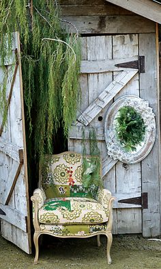 OK I guess this chair isn't going to stay here, but I do like the old doors and the greenery and the chair.S