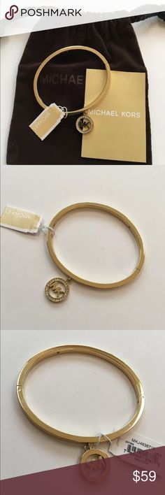 New Michael kors Fulton logo bangle bracelet gold Brand New with tags Michael kors Fulton logo bangle bracelet   Gold colored brass with pave crystal logo mk charm (not removable) Hinge closure.  Bracelet is about 2.5 inches in diameter and .3 inches wide. Includes signature dust bag Retail $115+ Michael Kors Jewelry Bracelets