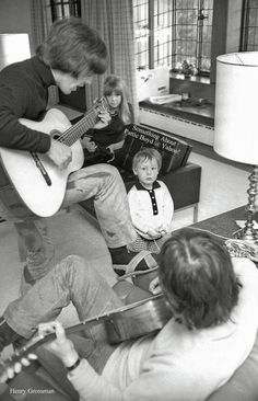 "Guitar Jam at Kenwood Late March 1965 - Pattie Boyd and Julian Lennon enjoy an impromptu guitar jam by George and John in the Lennon's home, Kenwood. Photograph by Henry Grossman from his book, ""Places I Remember - My Time With The Beatles."""