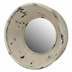 "Porthole-inspired brass wall mirror.     Product: Wall mirrorConstruction Material: Brass and mirrored glassColor: Distressed creamDimensions: 14.5"" Diameter"