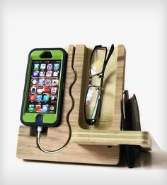Wooden iPhone dock with cord groove, glasses storage, and wallet slot. Kind of like an all-in-one night stand accessory.