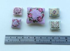 Tiny dollhouse cushions - even tinier than my usual kits! A blog post showing cushions made by one of my customers: the 'large' cushion is one and a quarter inches across, and stitched on 22 count canvas. The smaller ones are on 48 count silk gauze.