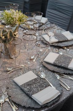Sequined napkin holders match the glamorous silver tablecloth and intricate charger plates. #silverchargers #rentsilverchargers #silverandwhitewedding #silverwedding #silverflorachargers