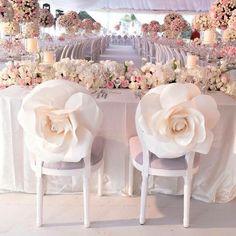 paper roses wedding chair decor / http://www.himisspuff.com/wedding-chair-decor-ideas/