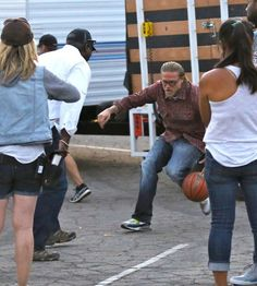 Charlie Hunnam Photos Photos - Actor Charlie Hunnam spotted on the set of 'Sons Of Anarchy' at the LA Zoo in Los Angeles, California on July 28, 2014. Also on set was Mark Boone Junior. Before leaving Charlie showed off some of his basketball moves to his favorite security guard on set. - Scenes from the 'Sons of Anarchy' Set