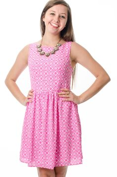 Want to be the center of attention at your next event? This pink patterned fit and flare dress will do it! Get yours now at lmaeboutique.com!