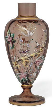 AN ENAMELLED SMOKY GLASS VASE CIRCA 1890 Oviform, enamelled with a bird in flight above a a leafy branch, wild flowers and scattered butterflies