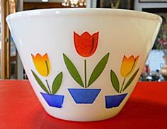 Large Fire King Tulip Bowl. I just got one of these with a lid. My husbands grandma used it to keep bacon grease in.
