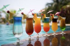Nothing better than a refreshing umbrella drink poolside! Re-pin, and let Grand Turizmo Travel help you find your next vacation. Our service and deals can't be beat. www.grandturizmo.com
