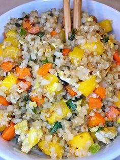 Put a tropical twist on this cauliflower fried rice by adding mango. You won't miss the carbs in this 21 Day Fix approved recipe!