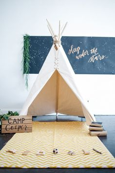 simple camping theme for baby's first birthday party - love the teepee!