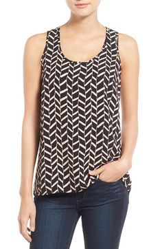 Stylist- Love tank tops that are long in the back. Really like this print also.