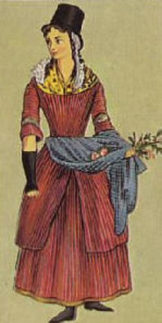 This Welsh girl from a painting of about 1830, shows how fashion lags behind in remote places. She wears a gown of 18th century cut, over a stiff corset, a printed neckerchief & a petticoat protected by a check apron. Her mittens & stockings being knitted. Her high crowned hat can be traced back to 17th century fashions. Many wore a red, caped cloak no different from that worn by English countrywomen in the 18th & 19th century.