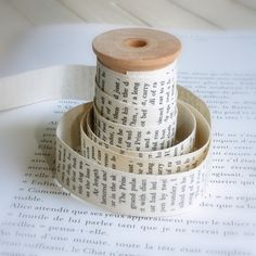 ribbon made from old book pages- maybe sew the segments together to make a long piece...
