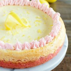 This recipe for Lemon Cheesecake with Strawberry Crust is the perfect dessert for Easter - or anytime you need a little happy in your life! It's so good!  Be