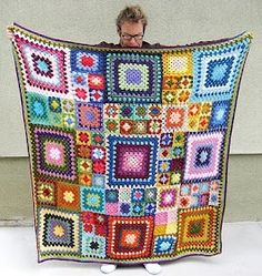 Crochet granny square blanket with various sizes.
