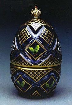"""(3) FABERGE egg__Theo Faberge __"""" Winter Egg """" A fusion of winter ice and festive cheer. The winter egg is a celebration of Christmas and the winter season. Made of cobalt blue and clear crystal and set with the Imperial Crown of Russia. Delicate bows and holly decorate the Egg.  On opening the Egg, the sterling silver base is engine turned in a starburst pattern. The vermeil crown winds up a music box that plays """"Silent Night""""."""