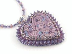 Dream a Little Dream beaded cabochon pendant and necklace. http://www.etsy.com/listing/64591615/dream-a-little-dream-beaded-cabochon #jewelry #beadwork #heart #necklace #pendant #purple