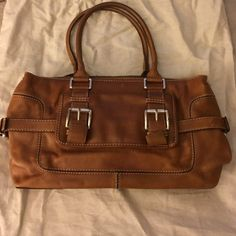MICHAEL Michael Kors Handbag Beautiful handbag. It has been used and has normal wear and tear. The bag is in great shape. The metal on the buckles is scratched. Also, the leather in the interior of the bag bled onto the liner. MICHAEL Michael Kors Bags