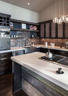 Ingenious kitchen backsplash crafted from reclaimed wood [Design: Jordan Iverson Signature Homes]