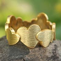 Gold plated heart ring, 'Much Love' from Novica $72.99 This band glistens with the power of love as 10 hearts shape a ring in a design by Thailand's Jantana. Featuring several heart sizes, the ring is crafted by hand of 24k gold plated sterling silver.