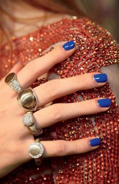 Bold blue nail polish pairs perfectly with a little sparkle.