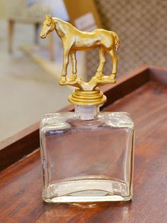 """Decorative glass bottle with horse topper at <a href=""""http://www.merridian.com/"""" target=""""_blank"""">Merridian</a> for $24"""