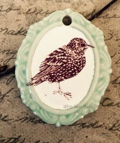 A personal favorite from my Etsy shop https://www.etsy.com/listing/245587941/starling-framed-pendant-starling-focal