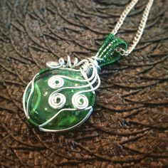Sold. Simple wire wrapped green glass. Www.etsy.com/shop/BlackRoseChris