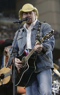 toby keith | CMT : Photos : All Toby Keith Pictures : Toby Keith and Football