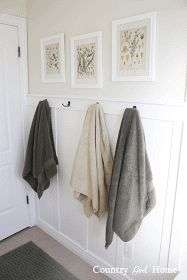 board and batten wall COUNTRY GIRL HOME : Bathroom board and batten wall with towell hooks Bathroom Towel Hooks, Hall Bathroom, Bathroom Kids, Modern Bathroom, Flamingo Bathroom, Remodled Bathrooms, Bathroom Hacks, Bathroom Hardware, Kids Bath