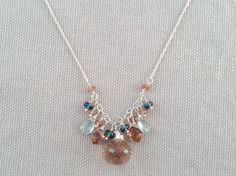 Handmade Necklace with Golden Rutilated Qtz, LB Topaz, Pink Andalusite, Moss Aqua by Indiana jewelry artist, Amber Bryce.