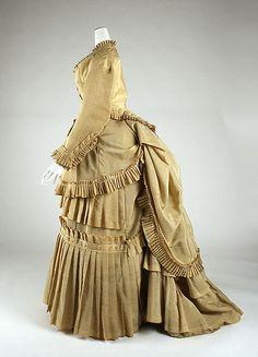 Dress Date: 1870–74 Culture: European Medium: wool, cotton Dimensions: Length at CB (a): 23 in. (58.4 cm) Length at CB (b): 48 in. (121.9 cm...