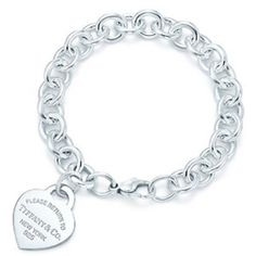 Tiffany and co silver charm bracelet authentic Authentic Tiffany and co charm bracelet. Return to Tiffany heart charm. Great condition! Only worn a few times. A bit tarnished but won't be tarnished after cleaning. Comes with box pouch and bag :) Tiffany & Co. Jewelry Bracelets