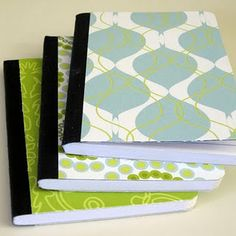 a quick fixer-upper: turn your composition notebooks from drab to fab with a little bit of adhesive and scrapbook paper