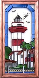 """Hilton Head Lighthouse (SC) Vertical Stained Art Glass Panel South Carolina's hexagonal Harbor Town Lighthouse beckons to boaters along the Intracoastal Waterway, and has become a symbol of Hilton Head Island.   Wood-framed in high-quality Wisconsin oak hardwood, this vertical panel of hand painted art glass depicting the lighthouse at Hilton Head measures 11.5"""" wide x 22.5"""" high #lighthouses #stainedartglass"""