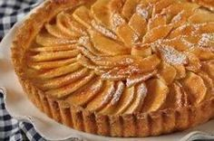 This classic French Apple Tart gives you a double dose of apples, a nicely flavored apple sauce filling topped with artfully arranged sliced apples. From Joyofbaking.com