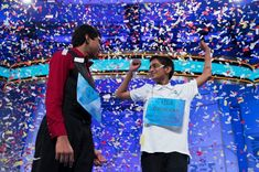 V-I-C-T-O-R-Y Image: Ansun Sujoe, 13, of Fort Worth, Texas, left, and Sriram Hathwar, 14, of Painted Post, N.Y., celebrate after being named co-champions of the National Spelling Bee, on Thursday, May 29, 2014, in Oxon Hill, Md.