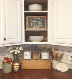 Farmhouse kitchen with butcher block countertops and subway tile.