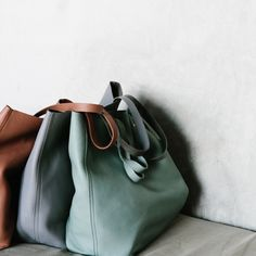 herpaperweight:  Madewell | three  of a kind / it took seven months to perfect the simplicity of our  iconic bag, and other little-known facts about the transport tote, on  the blog (link in bio) #totewell
