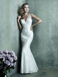 Allure Couture C291   Sleek with a vintage twist, we love this classic. Found at New York Bride & Groom in Charlotte, NC
