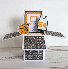 Box cards lay flat in an envelope, but pop up into a cool surprise! This basketball birthday card even has an extra pocket to hold birthday money or a gift card.