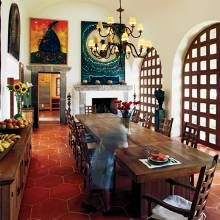 Painted a bright white, the dining room is bathed in light from a slot skylight in the barrel-vaulted ceiling and from arched windows with wood grids.