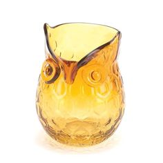 A little bit of geometric pattern, a lot of that undeniable owl charm, and a whole lot of style! The rich amber coloring of this unique glass decorative vase ma