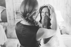 """Gorgeous shot by Amanda Eatonin Kansas City.She says, """"The bride, Monique, was having her veil put on by one of her bridesmaids and her friends were all speaking of how patiently she had waited to find her husband, the right man, and now today was finally the day she'd marry him."""""""